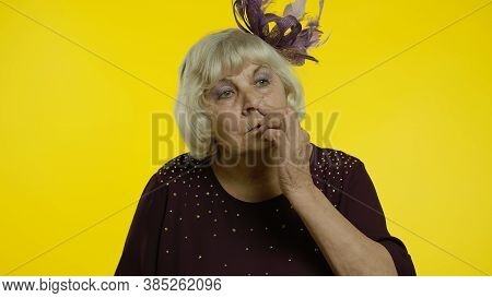 Funny Stupid Senior Old Woman Picking Nose With Silly Brainless Humorous Expression, Removing Booger