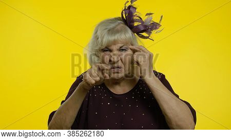 Displeased Annoyed Senior Old Woman Showing Stupid Gesture, Accusing Crazy Cuckoo Mind, Blaming Insa