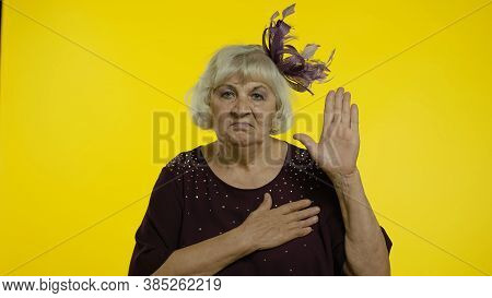 Honest Responsible Senior Old Woman Raising Hand, Touching Chest And Taking Vow, Saying Promise, Swe