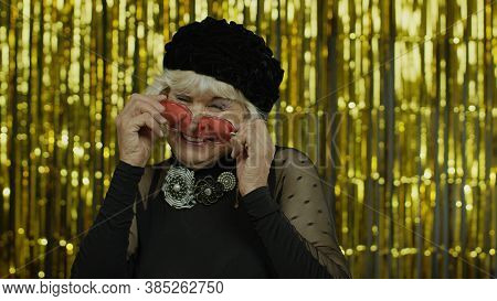 Lovely Coquettish Mature Old Woman Touching Red Sunglasses And Winking Playfully, Flirting And Blink