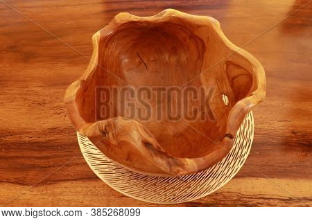 Empty Wooden Bowl On Wooden Background. Close Up Of A Carved Wooden Bowl. Decorative Wooden Bowl, Ar