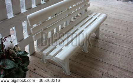 Common Plastic Public Bench In The Street For Passersby In Footpath