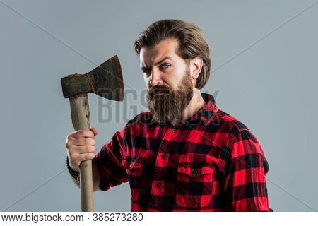 Cut Hair With Ax. Male Hairdresser Or Barbershop. Brutal Butcher In Shirt. Lumberjack Ready To Work