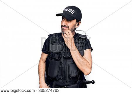 Middle age policeman wearing police uniform and bulletproof vest over white background thinking concentrated about doubt with finger on chin and looking up wondering