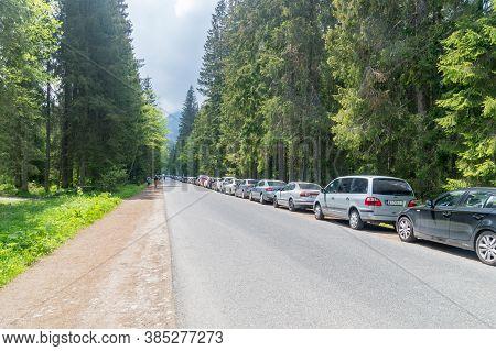 Lysa Polana, Poland - June 14, 2020: Cars Parked On The Road To Tatra National Park.