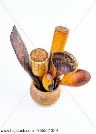 Ceramic Clay Jug With Wooden Kitchen Utensils.