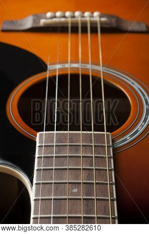 Detail Of The Fretboard And Body Of An Acoustic Guitar, Shallow Depth Of Field