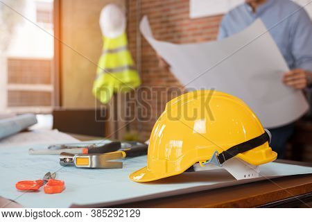 Engineer Or Architect Is Reading Paper Blueprint Project Plan. Civil Engineering, Architect Concept