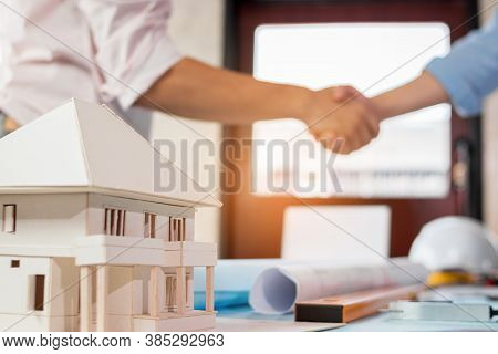 Engineer And Architecture Shaking Hand After Finish An Agreement. Real Estate Agent Shaking Hands Wi
