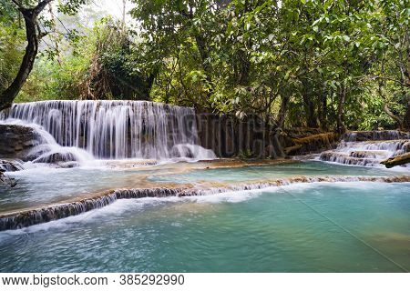 The Kuang Si Falls Or Known As Tat Kuang Si Waterfalls. These Waterfalls Are A Favorite Side Trip Fo