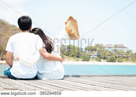 Loving Couple Sitting Embrace At Sea Outdoor Happy In Love Romantic And Relax Time. Romantic Couple