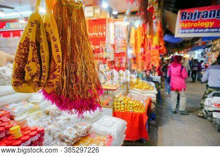 Haridwar, Garhwal, India - 3rd November 2018 : Auspicious Yellow Merchandise Hanging For Sale. Night