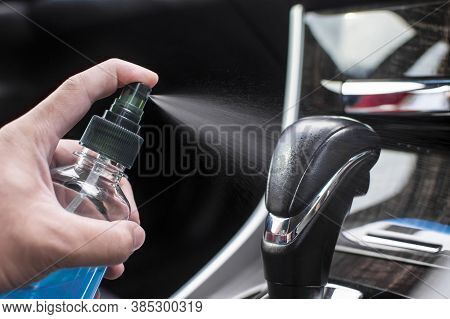 Cleaning Gear Lever With Alcohol Sanitizing Spray In A Car For Protection Disease And Antibacterial