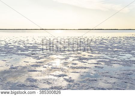 Landscape Of The Salt Lake. Salt Water Beach With Accumulations Of Salt That Come Out Of The Water,