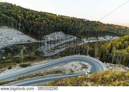 Dangerous Road Near Resort Town Of Belokurikha. Serpentine Road In Mountains Of The Altai On A Brigh