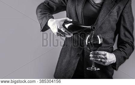 Gourmet Drink Bottle, Red Wine Glass, Sommelier, Tasting. Waiter Pouring Red Wine In A Glass. Sommel