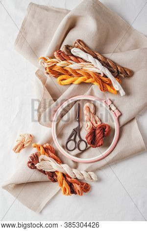 Set For Embroidery. Linen Fabric, Patterns For Embroidery, Hoop, Thread Of Yellow And Brown Colors A