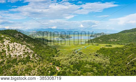 Beautiful Landscape Skadar (skoder) Lake Among The Mountains. This Section Of The Lake Overgrown Wit
