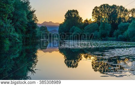View Chernoyevich's River Is Especially Beautiful At Sunset In An Environment Of The Mountains Of Mo