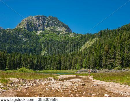 View Of The Black Lake And Mount Bobotov Kuk. Durmitor, Montenegro, Europe.