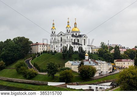 Belarus, Vitebsk - September 10, 2020: Holy Dormition Cathedral On River Bank