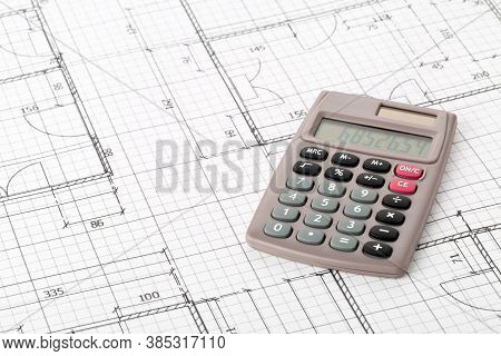 Calculator On Architectural House Building Blueprint Plan Background, Real Estate Or House Building