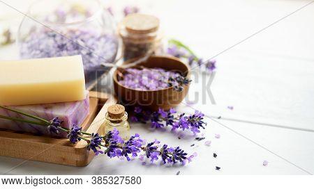 Handmade Soap On Wooden Soap Dish, Essential Oil And Lavender Bath Salt - Beauty Treatment. Lavender