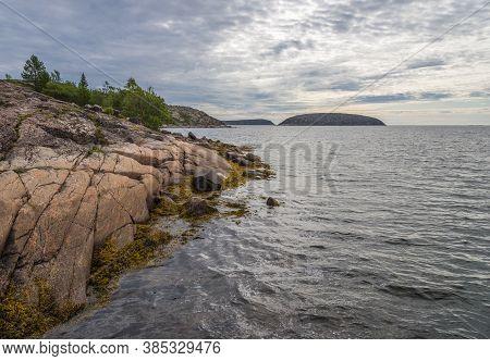 Rocky Island German Kuzov, Far Seen The Other Islands Of The Archipelago. Archipelago Kozova - State