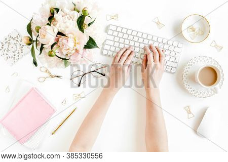 Flat Lay Womens Office Desk. Female Workspace With Female Hands, Computer, Pink Peonies Bouquet, Acc