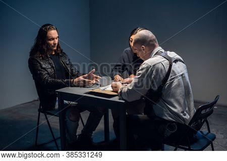 In The Police Stations Interrogation Room, Good And Bad Cops Are Questioning A Theft Suspect In A Le