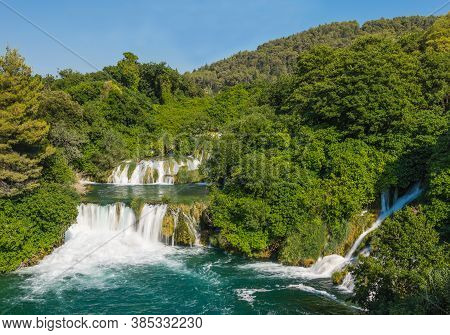 Cascading Waterfalls Krka In The Forest On A Sunny Day. Krka National Park, Croatia.