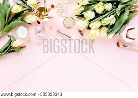 Female Workspace With Tulip Flowers Bouquet, Golden Accessories, Diary, On Pink Background. Flat Lay
