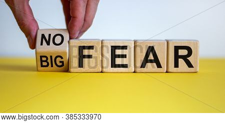 Hand Turns A Cubes And Changes The Expression 'big Fear' To 'no Fear' Or Vice Versa. Beautiful Yello