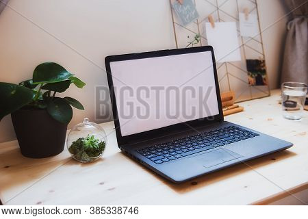 Side View Modern Minimalist Workplace With Laptop Mockup With White Empty Screen On Wooden Desk With