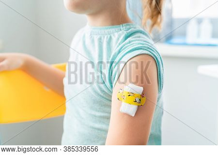 Vaccination Of Little Girl In Doctor's Office.kids Funny Adhesive Plaster,gauze Napkin.sits On Chair
