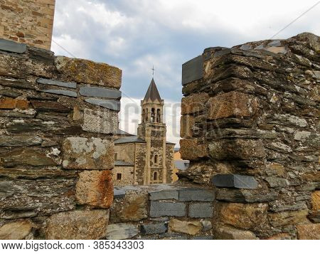 Tower Of San Andres Church In Ponferrada, Spain Seen Through Embrasure In A Parapet Wall Of The Temp