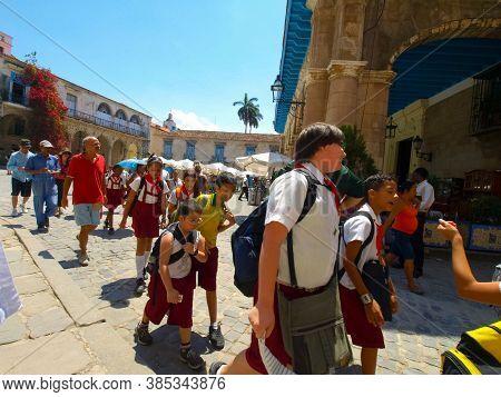 Havana, Cuba - April 03, 2013: Streets Of Havana, Passers-by On The Streets Of Havana. Hiking Walks
