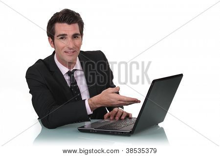 Businessman showing off his new laptop