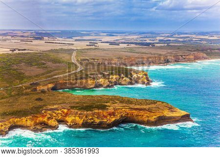 Scenic coastline. Picture taken from a helicopter. Great Ocean Road and the Twelve Apostles is a group of limestone cliffs. Port Campbell Park, Australia. The concept of extreme and photo tourism