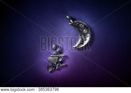 A Witch Flying To A Sabbath Under The Moon, Wiccan Symbols On A Dark Blue And Purple Background