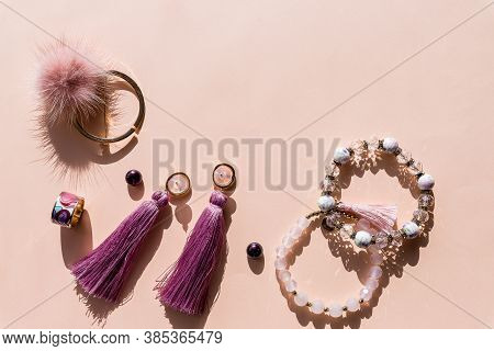 Womans Jewelry. Agate Bracelets, Rings And Earrings On A Light Background, Top View, Flat Lay, Copy