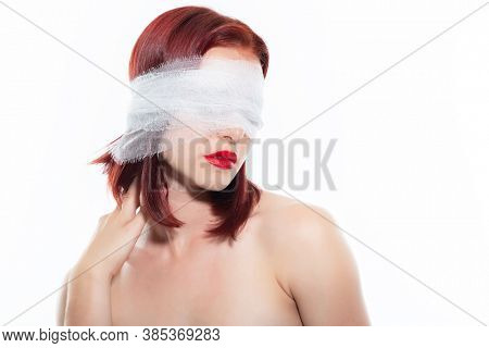 Patient after plastic or elective eye surgery. Girl with bandage on her head. Blind