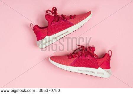 Pair Of New Pink Sneakers, Sport Shoes On Pink Background. Pink Womens Sport, Running Shoes