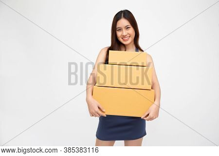 Happy Asian Woman Smiling And Holding Package Parcel Box Isolated On White Background, Delivery Cour