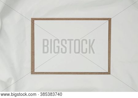 Blank White Paper On Brown Paper Envelope With White Cloth. Mock-up Of Horizontal Blank Greeting Car