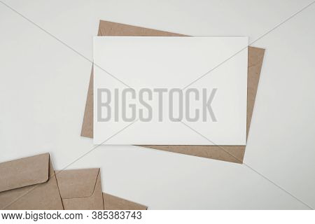 Blank White Paper On Brown Paper Envelope. Mock-up Of Horizontal Blank Greeting Card. Top View Of Cr