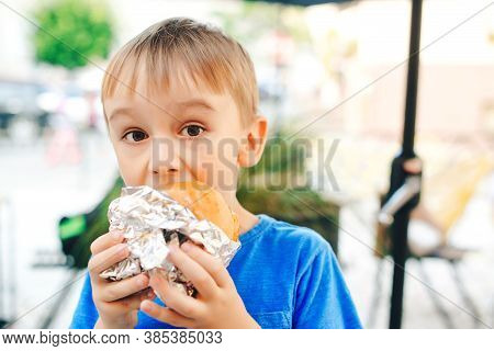 Cute Child Eating Fast Food. Childhood, Unhealthy Food Concept. Junky Food.