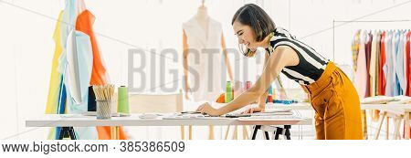 Young Asian Designer Woman Working With Computer And Choosing Multicolor Chart At Workplace, Small B