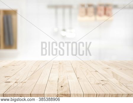 Wood Table Top On Blur Kitchen Counter (room)background.for Montage Product Display Or Design Key Vi