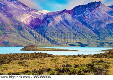 Los Glaciares is Argentina's most beautiful natural park. Huge lake with azure water, arid steppe of Patagonia and the steep slopes of cold mountains. The concept of extreme and photo tourism